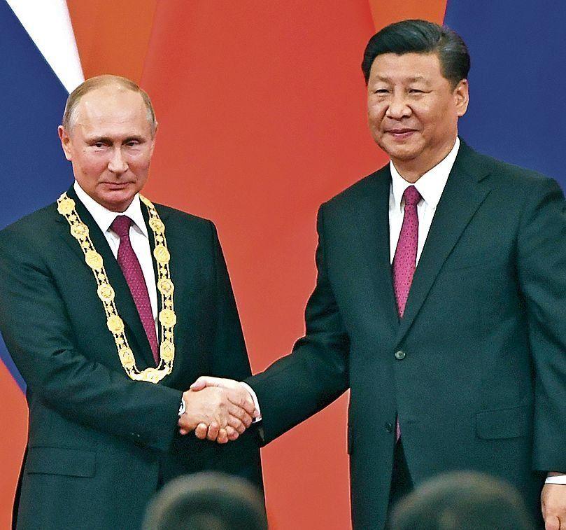dPutin fue distinguido por el presidente chino