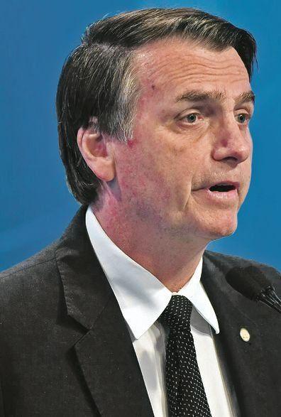 dLos candidatos presidenciales Jair Bolsonaro y Fernando Haddad.