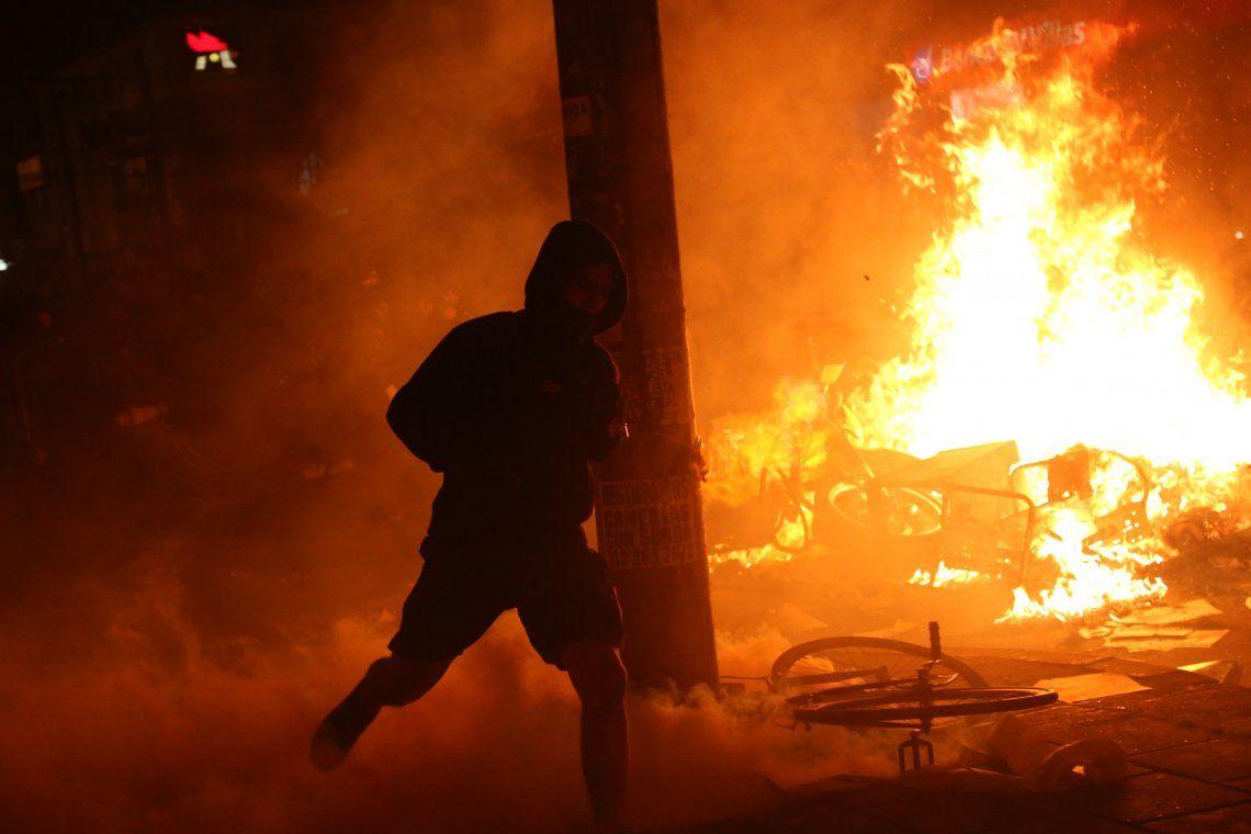En fotos: cinco muertos en las protestas contra el abuso policial enBogotá