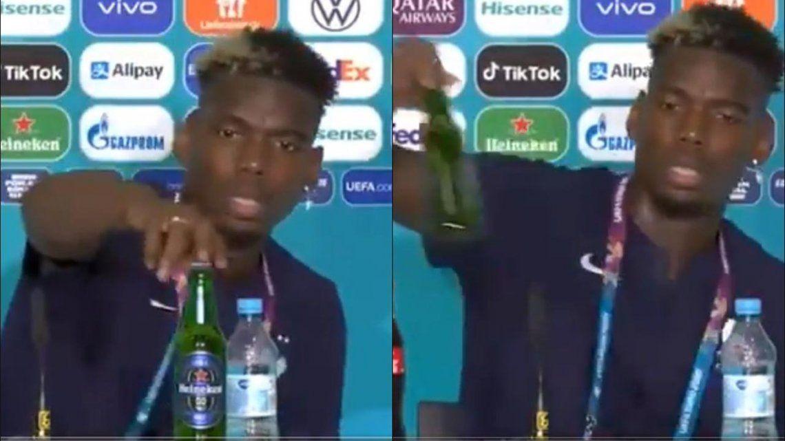 Paul Pogba retiró una cerveza en una conferencia de prensa.