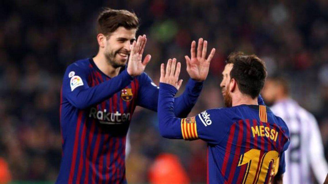 Gerard Piqué y Lionel Messi